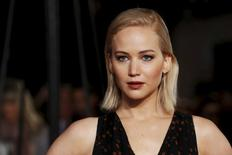 """Actress Jennifer Lawrence poses for photographers on the red carpet at the UK premiere of """"The Hunger Games: Mockingjay Part 2"""" at Leicester Square in London, Britain November 5, 2015. REUTERS/Luke MacGregor"""