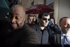 Martin Shkreli (C), chief executive officer of Turing Pharmaceuticals and KaloBios Pharmaceuticals Inc, departs the U.S. Federal Court after an arraignment following him being charged in a federal indictment filed in Brooklyn relating to his management of hedge fund MSMB Capital Management and biopharmaceutical company Retrophin Inc. in New York December 17, 2015. REUTERS/Lucas Jackson