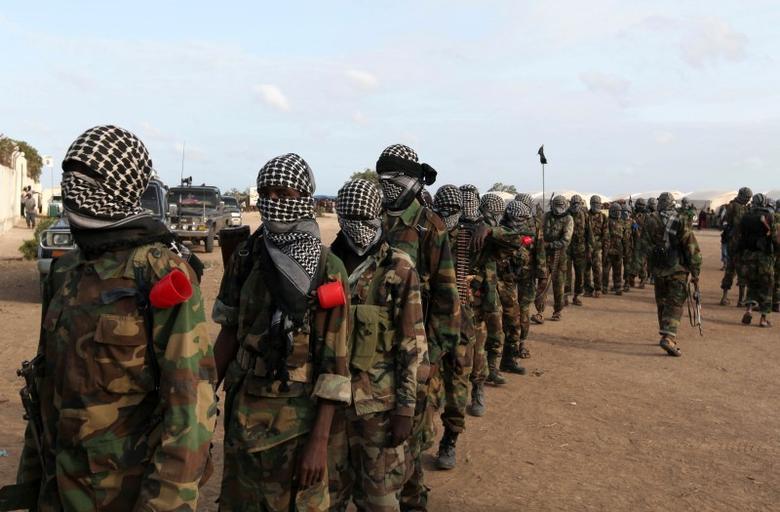 Members of al Shabaab parade at Ala Yaasir camp, outside of Somalia's capital Mogadishu, September 3, 2011. REUTERS/Feisal Omar