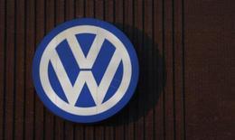 A Volkswagen company logo adorns the VW factory in Wolfsburg, Germany December 8, 2015.  REUTERS/Carl Recine
