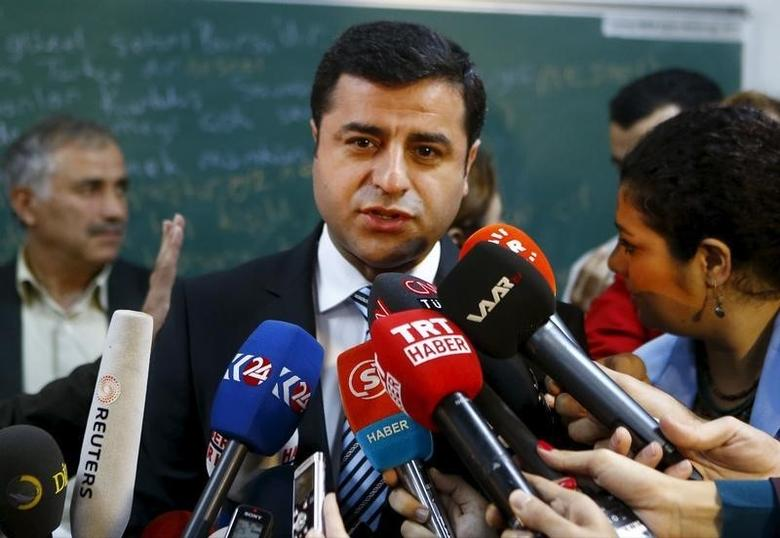 Selahattin Demirtas, co-chairman of the pro-Kurdish Peoples' Democratic Party (HDP), talks to the media before casting his ballot at a polling station during a general election in Istanbul, Turkey November 1, 2015.   REUTERS/Osman Orsal