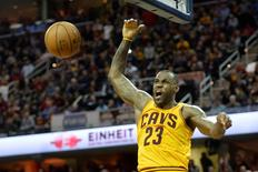 Dec 23, 2015; Cleveland, OH, USA; Cleveland Cavaliers forward LeBron James (23) reacts after a dunk against the New York Knicks in the fourth quarter at Quicken Loans Arena. Mandatory Credit: David Richard-USA TODAY Sports
