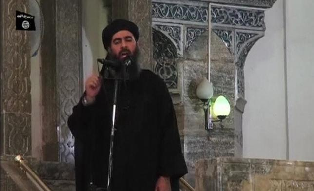 A man purported to be the reclusive leader of the militant Islamic State Abu Bakr al-Baghdadi has made what would be his first public appearance at a mosque in the centre of Iraq's second city, Mosul, according to a video recording posted on the Internet on July 5, 2014, in this still image taken from video. REUTERS/Social Media Website via Reuters TV