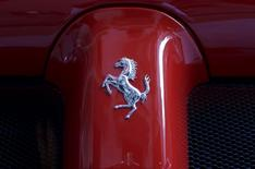 A Ferrari logo is seen on a Ferrari sports car outside the New York Stock Exchange October 21, 2015.  REUTERS/Brendan McDermid