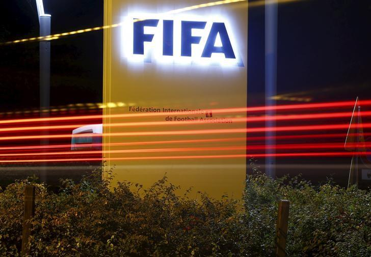 The FIFA logo is seen outside their headquarters in Zurich October 7, 2015. REUTERS/Arnd Wiegmann