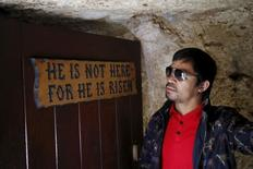 Filipino boxer Manny Pacquiao stands next to a sign during a visit to The Garden Tomb site outside Jerusalem's old city November 21, 2015. REUTERS/ Amir Cohen