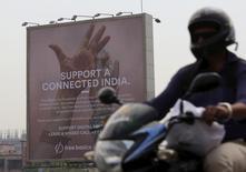 A motorist rides past a billboard displaying Facebook's Free Basics initiative in Mumbai, India, December 30, 2015. REUTERS/Danish Siddiqui