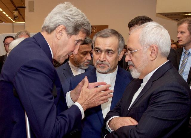 U.S. Secretary of State John Kerry (L) speaks with Hossein Fereydoun (C), the brother of Iranian President Hassan Rouhani, and Iranian Foreign Minister Javad Zarif (R), before the Secretary and Foreign Minister addressed an international press corps gathered at the Austria Center in Vienna, Austria, July 14, 2015. REUTERS/US State Department/Handout via Reuters