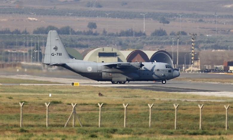 A Lockheed C-130 Hercules transport aircraft of the Royal Netherlands Air Force lands at Incirlik airbase in the southern city of Adana, Turkey, August 3, 2015. REUTERS/Umit Bektas