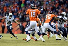 Jan 3, 2016; Denver, CO, USA; Denver Broncos quarterback Peyton Manning (18) prepares to pass the football in the third quarter against the San Diego Chargers at Sports Authority Field at Mile High. Mandatory Credit: Ron Chenoy-USA TODAY Sports