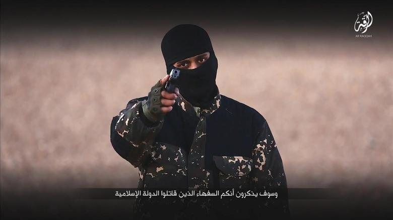 A masked man points a weapon as he speaks in this still image from a handout video obtained on January 4, 2016 from a social media website which has not been independently verified. REUTERS/Social Media via Reuters
