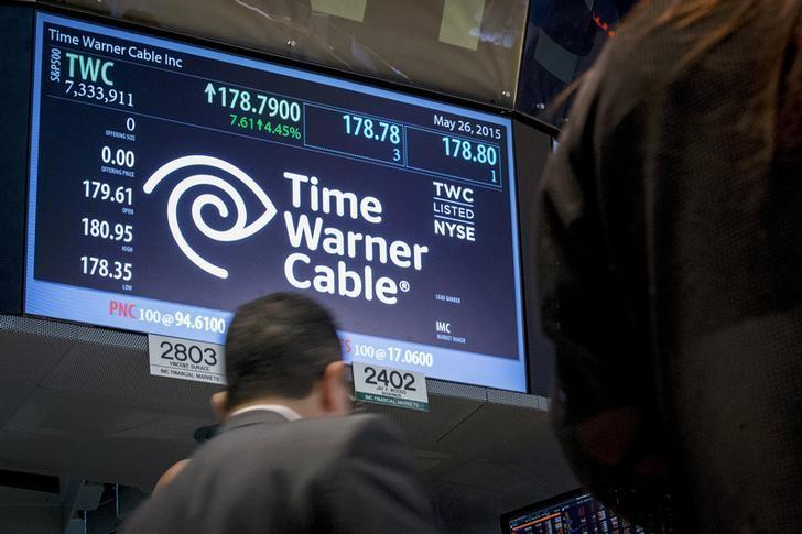 Traders work at the post where Time Warner Cable is traded on the floor of the New York Stock Exchange May 26, 2015.  REUTERS/Brendan McDermid