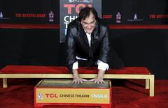 Director Quentin Tarantino places his handprints in cement in the forecourt of the TCL Chinese theatre in Hollywood, California January 5, 2016. REUTERS/Mario Anzuoni