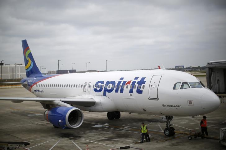 A Spirit Airlines airplane sits at a gate at the O'Hare Airport in Chicago, Illinois October 2, 2014.   REUTERS/Jim Young