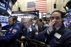 Traders work on the floor of the New York Stock Exchange in New York, January 6, 2016. REUTERS/Brendan McDermid