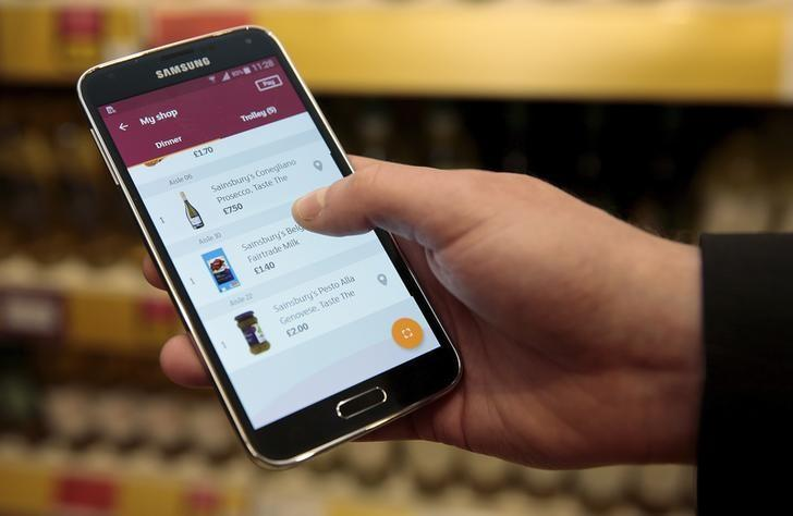 A journalist trials a mobile shopping app REUTERS/Suzanne Plunkett