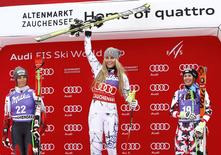 Lindsey Vonn (C) of the U.S. celebrates her victory next to second-placed Larisa Yurkiw (L) of Canada and third-placed Cornelia Huetter of Austria the Women's Sprint Downhill race of the Alpine Skiing World Cup in Zauchensee, Austria, January 9, 2016. REUTERS/Leonhard Foeger