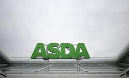 A sign is seen outside an Asda store in northwest London, Britain August 18, 2015.  REUTERS/Suzanne Plunkett