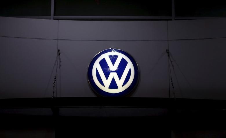 A logo of Volkswagen is illuminated at a dealership in Seoul, South Korea, November 25, 2015. REUTERS/Kim Hong-Ji