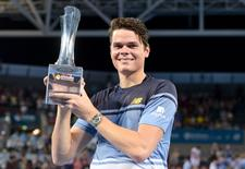 Milos Raonic of Canada holds the men's singles trophy after defeating Roger Federer of Switzerland at the Brisbane International Tennis Tournament in Brisbane, Australia, January 10, 2016.  REUTERS/Bradley Kanaris/AAP