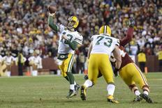 Jan 10, 2016; Landover, MD, USA; Green Bay Packers quarterback Aaron Rodgers (12) throws a touchdown pass against the Washington Redskins during the first half in a NFC Wild Card playoff football game at FedEx Field. Mandatory Credit: Tommy Gilligan-USA TODAY Sports