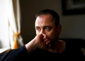 Former British soldier Rob Lawrie poses during an interview with Reuters at his home in Guiseley, Britain January 6, 2016. REUTERS/Darren Staples