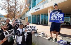 Jan 12, 2016; Houston, TX, USA; San Diego Chargers fan Richard Farley , right, along with Raiders fans hold signs supporting their teams while owners met at the 2016 NFL owners meeting at the Westin Houston.  Mandatory Credit: Thomas B. Shea-USA TODAY Sports