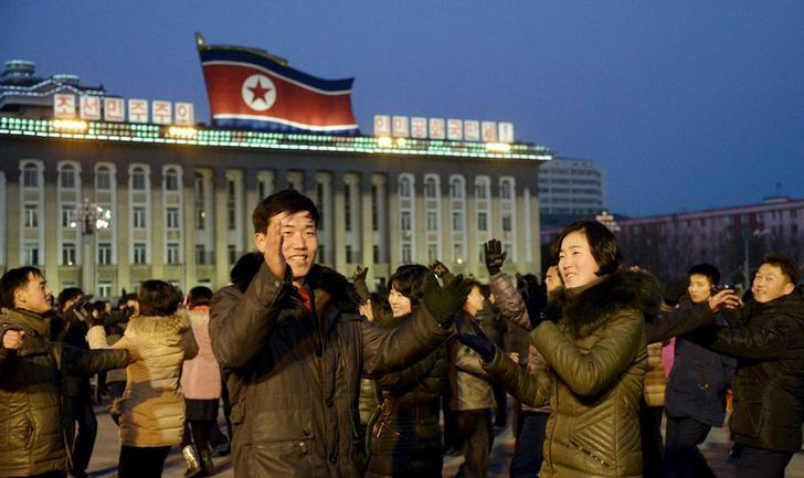 North Koreans dance to celebrate what the country claims was a ''successful hydrogen bomb'' test at Kim Il Sung square in Pyongyang, North Korea, in this photo released by Kyodo January 8, 2016.  REUTERS/Kyodo