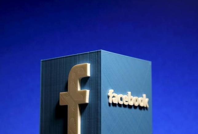 A 3D plastic representation of the Facebook logo is seen in this illustration in Zenica, Bosnia and Herzegovina, May 13, 2015. REUTERS/Dado Ruvic/Files