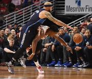 Jan 15, 2016; Chicago, IL, USA; Dallas Mavericks guard Deron Williams (8) and Chicago Bulls guard Jimmy Butler (21) go for a loose ball during the second half at the United Center. The Dallas Mavericks won 83-77. Mandatory Credit: David Banks-USA TODAY Sports