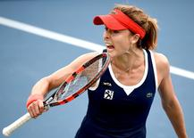 Aug 10, 2015; Toronto, Ontario, Canada; Alize Cornet of France reacts to a line call while playing against Carla Suarez Navarro of Spain (not pictured) during the Rogers Cup tennis tournament at Aviva Centre. Mandatory Credit: Dan Hamilton-USA TODAY Sports