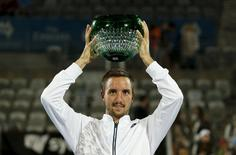 Viktor Troicki of Serbia holds the Sydney International tennis men's singles trophy aloft after defeating Grigor Dimitrov of Bulgaria in Sydney, January 16, 2016.   REUTERS/Jason Reed