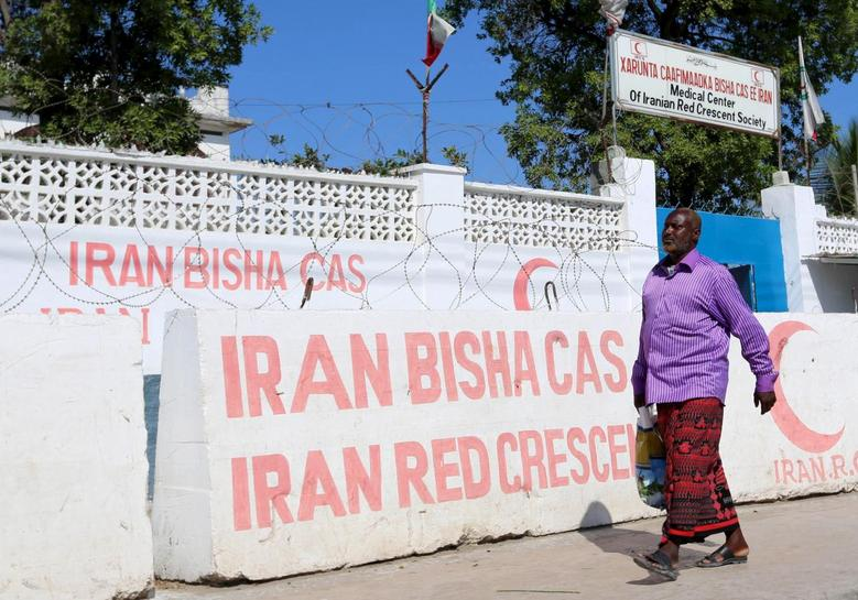 A Somali man walks in front of the Iranian Red Crescent premises after the government ordered all Iran-related operations to leave within 72 hours in Mogadishu January 12, 2016. REUTERS/Feisal Omar