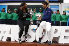 Current Australian Open Men's and Women's champions Serbia's Novak Djokovic and Serena Williams of the U.S. hold their trophies as they pose for a photograph after arriving for the official draw ceremony at Melbourne Park, Australia, January 15, 2016. REUTERS/David Gray