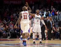 Jan 18, 2016; Los Angeles, CA, USA; Los Angeles Clippers guard Chris Paul (3) and guard Jamal Crawford (11) celebrate during an NBA basketball game against the Houston Rockets at Staples Center. The Clippers defeated the Rockers 140-132 in overtime. Mandatory Credit: Kirby Lee-USA TODAY Sports