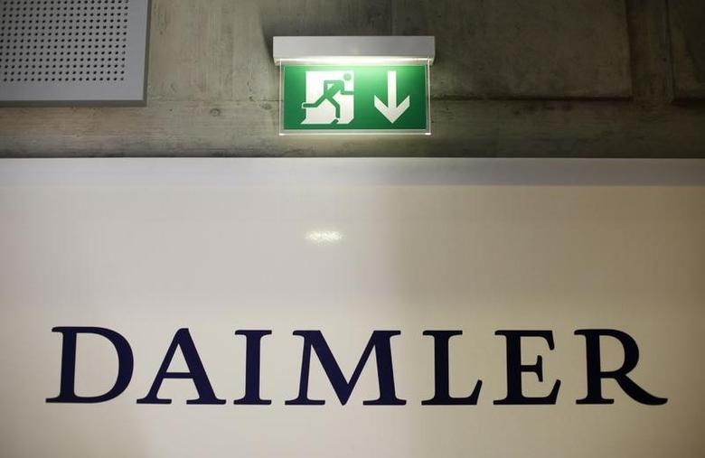 A emergency exit sign is pictured above a logo of German car manufacturer Daimler AG, before the annual news conference in Stuttgart February 18, 2010. REUTERS/Johannes Eisele