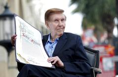 Sumner Redstone, executive chairman of Viacom and CBS Corporation, holds a proclamation to his name before unveiling his star on the Walk of Fame in Hollywood, California in this March 30, 2012 file photo. REUTERS/Mario Anzuoni/Files