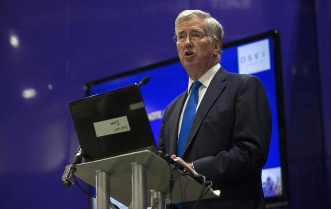 Secretary of Defence Michael Fallon delivers a speech at the Defence and Security Equipment International trade show in London, Britain September 16, 2015. REUTERS/Neil Hall