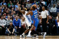Jan 19, 2016; Denver, CO, USA; Oklahoma City Thunder forward Kevin Durant (35) dribbles the ball as Denver Nuggets forward Kenneth Faried (35) defends in the second quarter at the Pepsi Center. Mandatory Credit: Isaiah J. Downing-USA TODAY Sports
