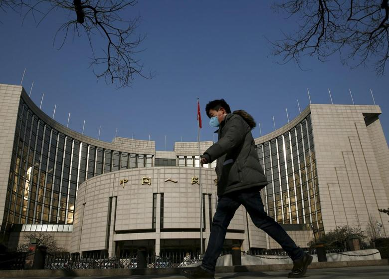A man walks past the headquarters of the People's Bank of China, the country's central bank, in Beijing, China, January 19, 2016.  REUTERS/Kim Kyung-Hoon