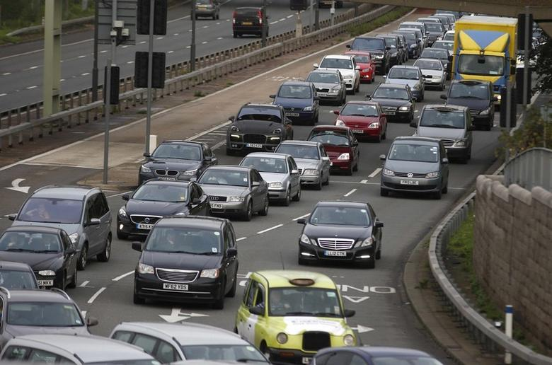 A file photograph shows a traffic jam as cars head towards the approach tunnel of Heathrow Airport, west London, Britain November 26, 2015. REUTERS/Peter Nicholls/files