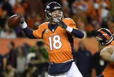 Jan 3, 2016; Denver, CO, USA; Denver Broncos quarterback Peyton Manning (18) prepares to pass the football in the fourth quarter against the San Diego Chargers at Sports Authority Field at Mile High. The Broncos defeated the Chargers 27-20. Mandatory Credit: Ron Chenoy-USA TODAY Sports