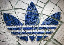 The Adidas logo on a 3D city map is pictured at the flagship store in Berlin, Germany, January 20, 2016.  REUTERS/Hannibal Hanschke