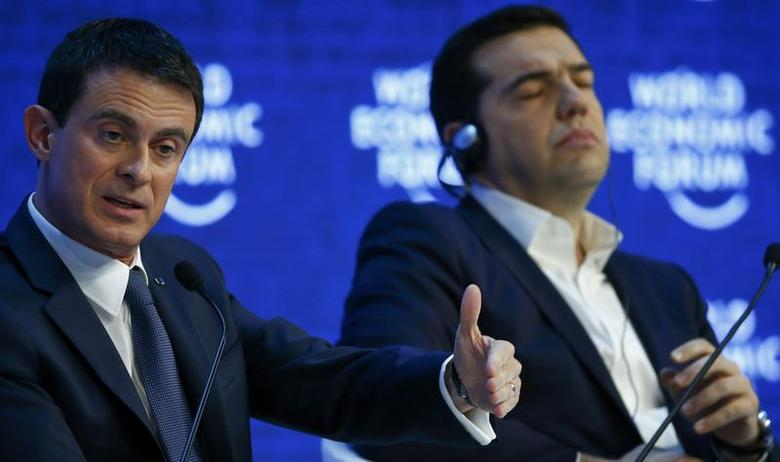 French Prime Minister Manuel Valls (L) speaks next to Greek Prime Minister Alexis Tsipras during the session 'The Future of Europe' at the annual meeting of the World Economic Forum (WEF) in Davos, Switzerland January 21, 2016. REUTERS/Ruben Sprich