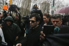 Martin Shkreli (C), chief executive officer of Turing Pharmaceuticals and KaloBios Pharmaceuticals Inc, departs the U.S. Federal Court in New York December 17, 2015. REUTERS/Lucas Jackson