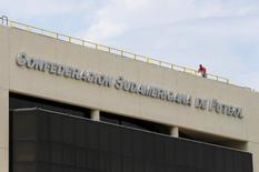 A worker stands on the roof of the headquarters of the South American Soccer Confederation (CONMEBOL) in Luque, Paraguay, December 3, 2015. REUTERS/Jorge Adorno