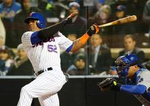 Oct 30, 2015; New York City, NY, USA; New York Mets center fielder Yoenis Cespedes (52) drives in a run with a sacrifice fly against the Kansas City Royals in the sixth inning in game three of the World Series at Citi Field. Mandatory Credit: Anthony Gruppuso-USA TODAY Sports