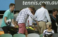 Nigel Sears, coach of Serbia's Ana Ivanovic, is carried away on a stretcher after he collapsed during Ivanovic's third round match against Madison Keys of the U.S., causing play to be suspended, at the Australian Open tennis tournament at Melbourne Park, Australia, January 23, 2016. REUTERS/Brandon Malone