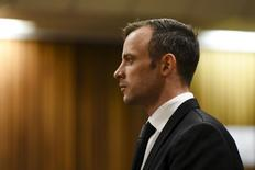 Oscar Pistorius stands in the dock at the North Gauteng High Court in Pretoria, South Africa for a bail hearing, December 8, 2015. REUTERS/Herman Verwey/Pool