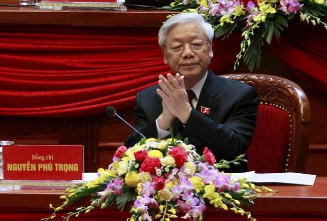 Vietnam's General Secretary of the Communist Party Nguyen Phu Trong applauds at the opening ceremony of the 12th National Congress of Vietnam's Communist Party in Hanoi, Vietnam, January 21, 2016. REUTERS/Kham